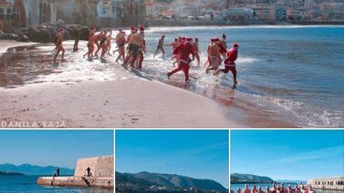 Sole e caldo in Sicilia, a Cefalù si festeggia il Natale con un tuffo a mare – LE IMMAGINI